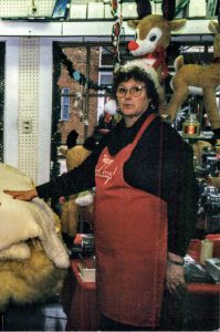 Shirley Evert working at The Corner News Store in Millbrook, New York at Christmas time
