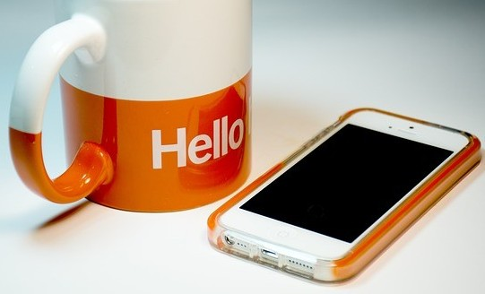 Hello on Mug and cell phone