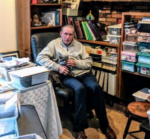John Kading organizing his picture collection of Millbrook, New York